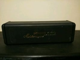 black Hohner harmonica,and case