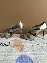 pair of glittered silver peep-toe heeled shoes