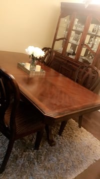 rectangular brown wooden table with 6 chairs dining set with china cabinet in very good condition only 6 months old  3153 km