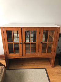 brown wooden framed glass cabinet St Catharines, L2R 5W8