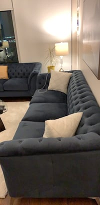 Blue suede sectional sofa and love seat with throw pillows