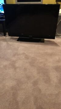 black flat screen TV with remote Round Hill, 20141