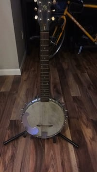 brown and black acoustic guitar Abbotsford, V4X 2S7