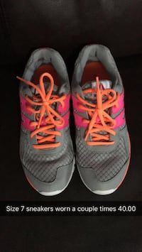 pair of gray-and-pink Nike running shoes Halifax, B2V 1C9