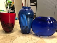 three red and blue glass jars