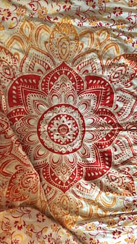 White, red, and brown floral textile