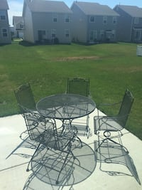 round black metal table with four chairs patio set St Charles