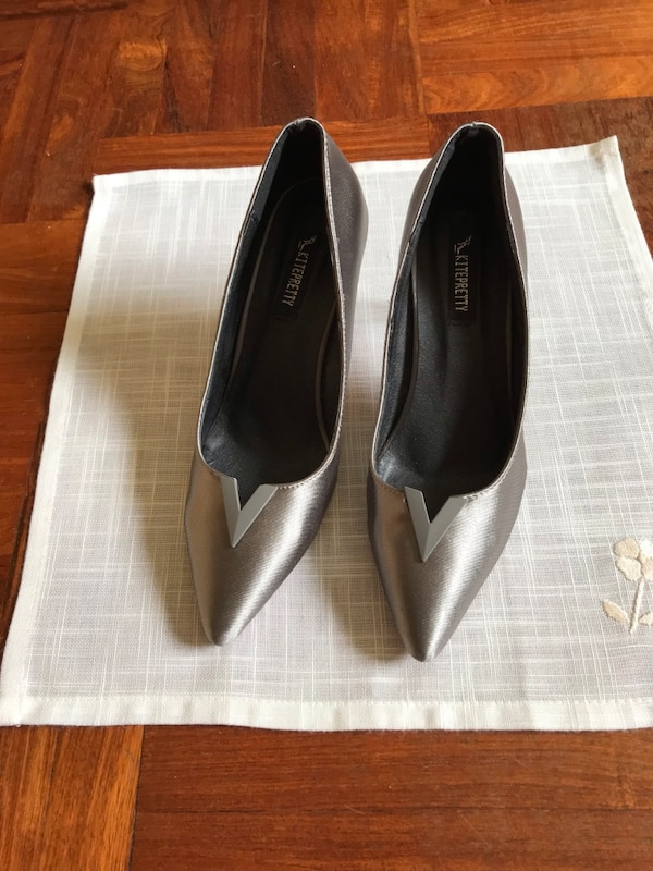 Pair of greyish pointed-toe pumps