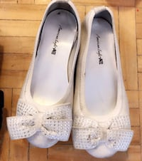 pair of white leather flats Toronto, M3N 2H4