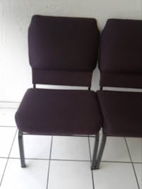 Padded chair with side hooks to connect another chair