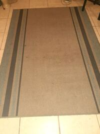Beige and brown and grey area rug