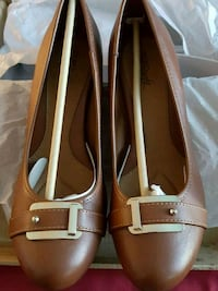 pair of brown leather loafers