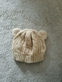 brown and white knit cap Lorton