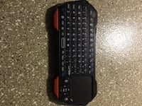 black Logitech wireless computer keyboard 43 km
