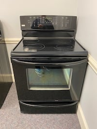 Kenmore elite glass top stove with convection oven 4 month warranty