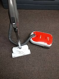 white and red canister vacuum