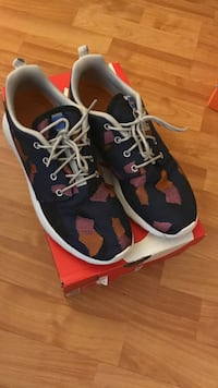Pair of navy, pink and orange nike running shoes size 9 North Providence, 02904