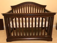Baby's brown wooden convertible crib Columbia, 21044