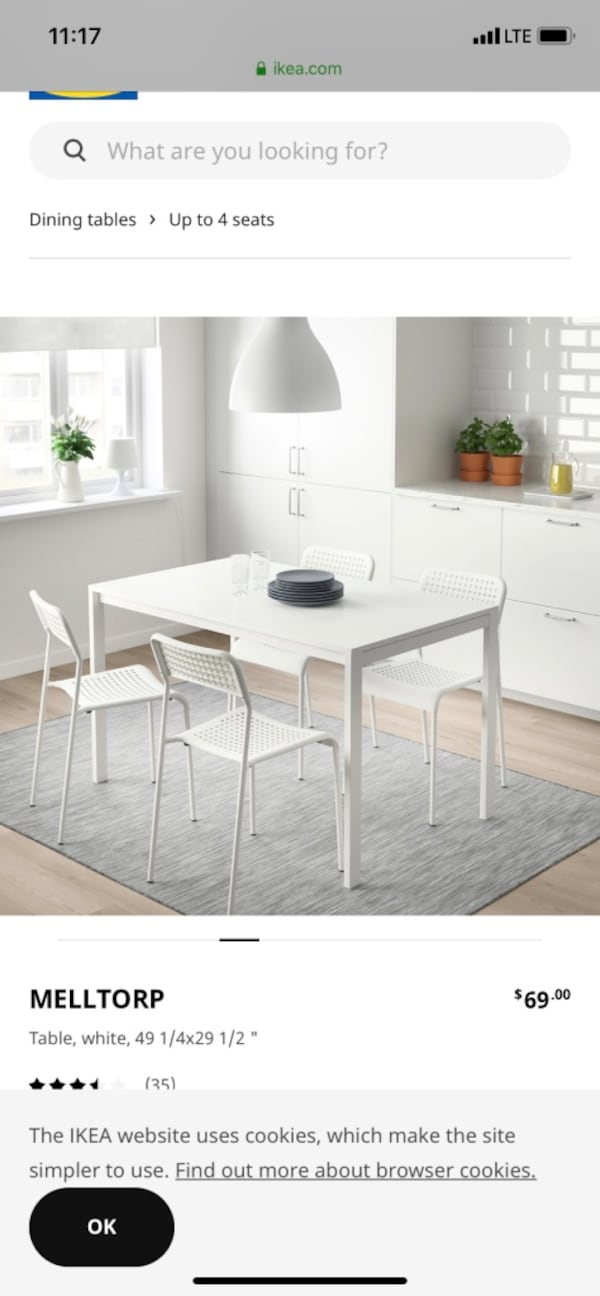 Ikea table and 4 chairs 4a93f9a6-b6d9-46bb-96f1-0d04847e2422