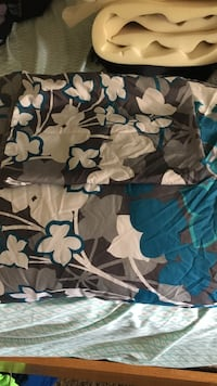 Black,gray, white, and blue floral blanket