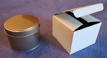 Round copper-colored tin containers