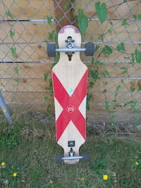 brown and red wheeled cutout longboard 2294 mi