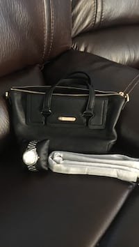 black leather 2-way tote bag and round silver analog watch with silver link