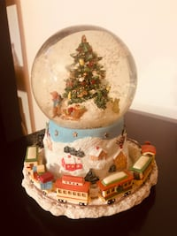 Musical snow globe. Train moves.