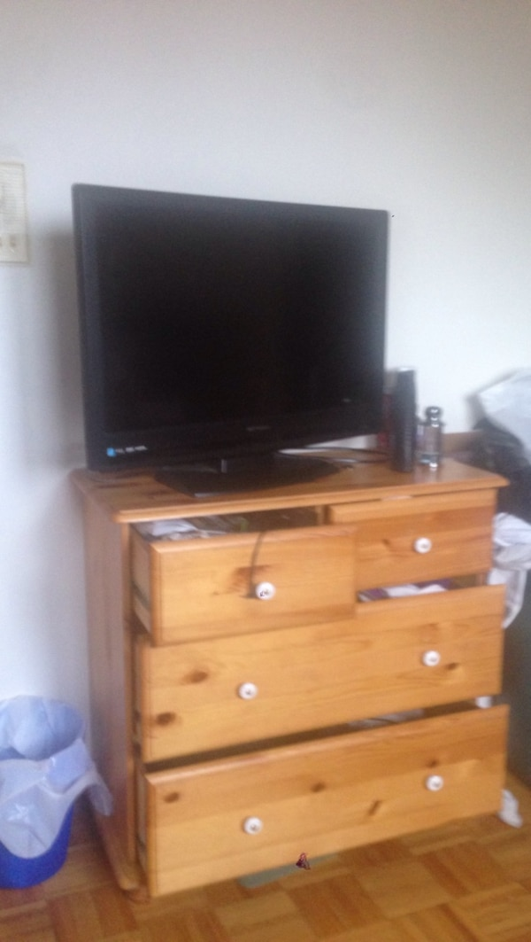 flat screen television with brown wooden TV stand
