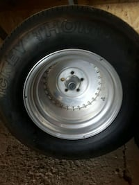 gray bullet hole car wheel with tire St. Catharines, L2P 1X2