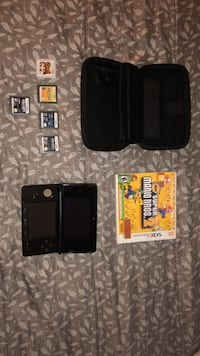 Black nintendo ds with game cartridges Santa Ana, 92704