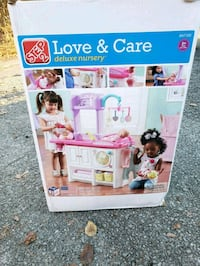 white and pink plastic toy box 449 mi