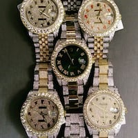 four round gold-colored analog watches California