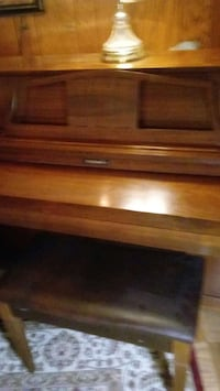 brown wooden upright piano with bench Burke, 22015