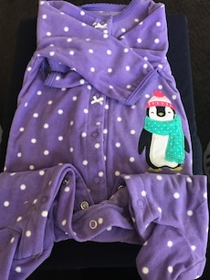baby's purple and white polka dotted penguin print footed onesie sleeper