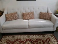 Cream couch 79 inches long. pillows not included.  Alexandria, 22306