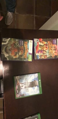 three assorted Xbox 360 game cases Harlingen, 78552