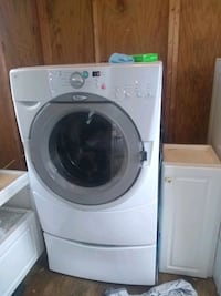 Whirlpool washer and dryer upright.