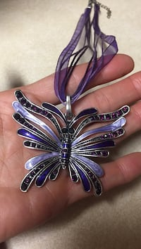 Silver-colored and purple butterfly pendant