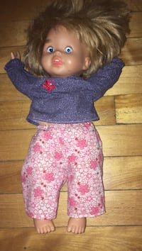 girl in blue and pink floral dress doll Montreal, H3W 2E7
