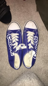 pair of blue Converse All Star low-top sneakers