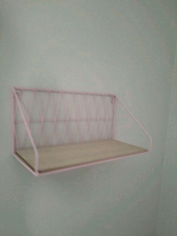 white and pink wooden rack