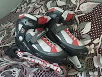 pair of white, gray and red roller blades Laval, H7T 2E6