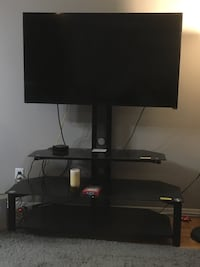 black flat screen TV with black TV stand Toronto, M2N 3C8
