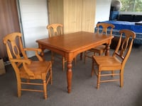 rectangular brown wooden table with four chairs dining set KELOWNA