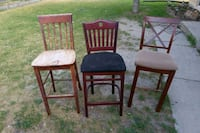 four brown wooden framed white padded chairs West Valley City, 84119