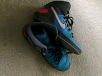 pair of blue-and-black Nike basketball shoes 11 km