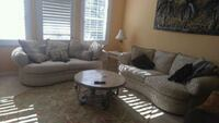 gray suede sectional couch with throw pillows