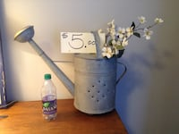 gray watering can
