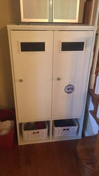 white and brown wooden cabinet 2 km